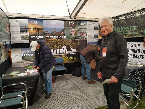 Alan Simmons on Outdoors Party stand and people signing up at the Sika show, Taupo, 2019